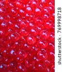 red pearls made from starch. | Shutterstock . vector #769998718