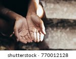 selective focus. hands poor... | Shutterstock . vector #770012128