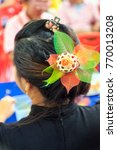 Small photo of A beautiful bouquet of potpourri adorn the hair asian girl.