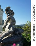 Small photo of Corfu Island.Darkened from time marble statue of Achilles.