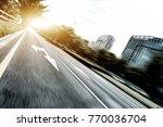 blurry view of empty asphalt... | Shutterstock . vector #770036704