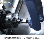 close up robot hands in milling ... | Shutterstock . vector #770043163