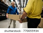 Small photo of Caucasian couple is lifting thing from shelf