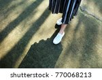 white sneakers shoes. woman is... | Shutterstock . vector #770068213