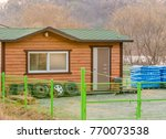 Small Wooden Storage Shed With...