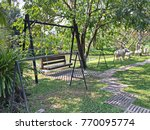 Wooden Swing With Sheep Statue...