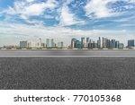 empty asphalt road with city... | Shutterstock . vector #770105368