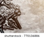 bolts and nut on steel plate. | Shutterstock . vector #770136886