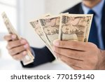 businessman counting money... | Shutterstock . vector #770159140