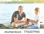 Father With Son Fishing From...