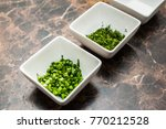 white dishes of finely cut dill ... | Shutterstock . vector #770212528
