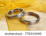 pair of wedding rings on golden ... | Shutterstock . vector #770214340