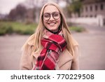 young woman wearing glasses... | Shutterstock . vector #770229508