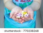 the child holds a fruit chewing ... | Shutterstock . vector #770238268