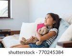 young girl embracing teddy bear ... | Shutterstock . vector #770245384