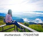 asian woman trekker sitting on...   Shutterstock . vector #770245768