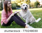 image of woman on walk with... | Shutterstock . vector #770248030