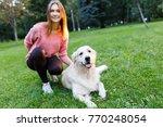 image of brunette with labrador ... | Shutterstock . vector #770248054