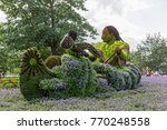 Small photo of GATINEAU, CANADA – AUGUST 27, 2017: A sculpture of a First Nations person rowing a canoe at the MOSAICANADA 150 exhibition celebrating the 150 anniversary of Canada.