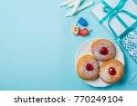 symbols of hanukkah on blue... | Shutterstock . vector #770249104