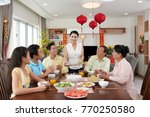 smiling housewife bringing main ... | Shutterstock . vector #770250580