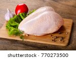 raw chicken breast with skin | Shutterstock . vector #770273500