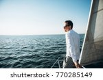 an attractive young guy swims... | Shutterstock . vector #770285149