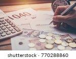 hand using pen writing tax...   Shutterstock . vector #770288860