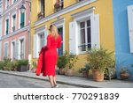 girl in red dress walk on... | Shutterstock . vector #770291839