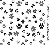 dog paw print seamless pattern... | Shutterstock . vector #770303608