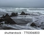 waves wash the wreckage of the... | Shutterstock . vector #770306803