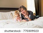 cute little girl reading a book ... | Shutterstock . vector #770309023