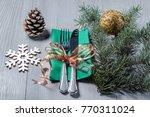 knife and fork on green napkin... | Shutterstock . vector #770311024