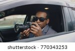 private detective man sitting... | Shutterstock . vector #770343253