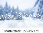 snowy winter christmas bokeh... | Shutterstock . vector #770347474