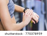 cropped shot of woman checking... | Shutterstock . vector #770378959