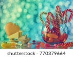 colored candy on blurred bokeh... | Shutterstock . vector #770379664
