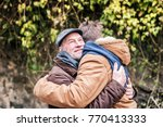 senior father and his young son ... | Shutterstock . vector #770413333
