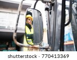 woman forklift truck driver in... | Shutterstock . vector #770413369