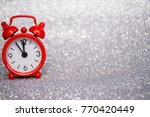the red clock to the left of... | Shutterstock . vector #770420449