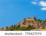 the castle of molyvos against a ... | Shutterstock . vector #770427574