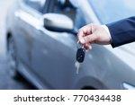 businessman holding car keys... | Shutterstock . vector #770434438