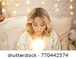 young beautiful woman sitting... | Shutterstock . vector #770442574