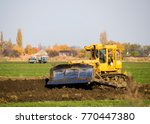The Yellow Tractor With...