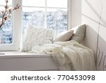 cushions and a knitted plaid on ... | Shutterstock . vector #770453098