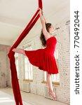 beautiful aerialist girl doing... | Shutterstock . vector #770492044