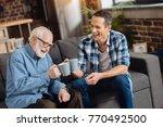 father son bonding. cheerful... | Shutterstock . vector #770492500