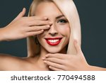 beautiful smiling woman closing ... | Shutterstock . vector #770494588