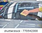 wipe the car glass car glass... | Shutterstock . vector #770542300