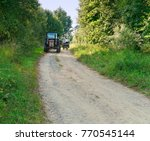 a tractor ride on a gravel road ... | Shutterstock . vector #770545144